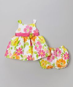 Colorful flowers frolic across this fun-loving frock. A rosette-sweetened waist and roomy skirt create a twirl-worthy piece that little princesses will feel extra pretty in.