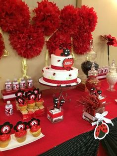 Pom-poms, cake and treats at a Ladybug girl birthday party!  See more party ideas at CatchMyParty.com!