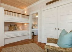Love the double closet doors & planked walls ~ from House of Turquoise: Pat O'Neal Interiors