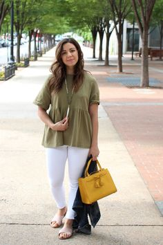 Lifestyle Blogger Roxanne of Glass of Glam wearing an army green peplum top, white denim, kate spade bag, and pink slides