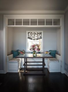 Breakfast nook with U-shaped banquette seating.