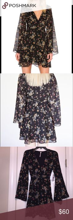Free People Lilou Mini Dress New with tags! Black mini dress. Side zipper,?100% polyester. Adjustable waist tie. 29 inches long. Free People Dresses Mini
