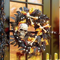Improvements Skull and Bones Halloween Wreath (310 HRK) ❤ liked on Polyvore featuring home, home decor, holiday decorations, halloween decor, halloween door decoration, outdoor halloween decor, skull wreath, halloween wreaths, door wreaths and artificial door wreaths
