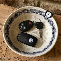 Natural Cotton Rope Bowl, Rope Basket, Coiled Rope Basket, Storage Basket, Cotton Rope Basket, Rope Bowl, Boho, Earth Friendly -------------------------------- Stylish, practical, and one-of-a-kind, this natural cotton upcycled coiled rope bowl is a great way to add color and texture to any space, and so traditional feeling. It's functional and decorative, hand made on a treadle sewing machine and finished by hand with an original vintage button. The perfect accent in the kitchen, bedroom...