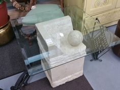 This is one cool coffee table and only $99! Glass top on a stone base #owensound #homedecor #furniture #trend
