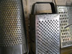 Would be funky - gather up our vintage cheese graters for display.