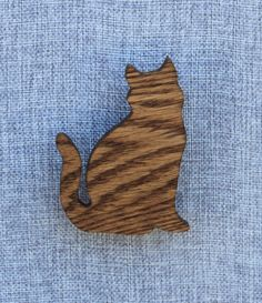 Cat magnet hand cut on a scroll saw from 1/4 red oak. The wood shapes are then sanded smooth. They are then finished with tinted danish oil to seal in their beauty. Finally, small neodymium rare earth magnets are inset into the back. These magnets are super strong and will easily hold any paper or photo to your refrigerator.  The cat measures approximately 3 by 4  Due to the nature of wood grain and the hand finish each magnet is slightly different. You may not receive the exact ones…