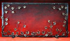 Very pretty fireplace screen made by a blacksmith. There are lots of them still around, you know?