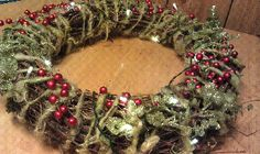 grapevine wreath, handspun yarn, fake floral, LED battery powered lights = undying (Christmas) wreath.