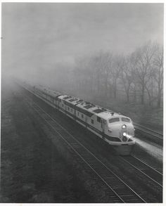 1947 promotional photo showing the Great Northern's flagship passenger train, the Chicago-Seattle Empire Builder running through fog west of Chicago. Leading the train are two nearly-new E7A diesel locomotives from General Motors' Electro-Motive Division. The railroad may have been showing off its new acquisitions in the photo, a common practice, especially on premier passenger trains.