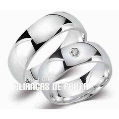 Alianças Compromisso Bonita  Peso aproximado: 13 gramas o par Largura: 6,00 mm Pedra: 1 Zirconia Anatômica  Acabamento  Liso