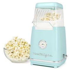Nostalgia Nostalgia 12 Cooked Cups Retro Hot Air Popcorn Maker,As a kid, whenever my family went to the movies, my mother used to pop up a great big pot of popcorn and portion it into little brown paper bags for u...