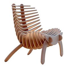 This sculptural wooden chair features vertical slats that make a strange statement and looks something like a cartoon fish skeleton. Designer Nicolas Marzouanlian developed this eco-friendly indoor or patio chair to be a purist piece of furniture making it without the use of glue or screws.http://www.sanyartspace.com/space/2009/10/15-must-see-outrageous-modern-chair-designs/