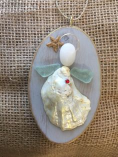 Beachcomber angel by BeachcombercraftArt on Etsy https://www.etsy.com/listing/517388583/beachcomber-angel