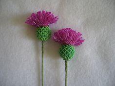 Hand Stitched Glass Bead Fuchsia Scottish Thistle Flower. $18.00, via Etsy.