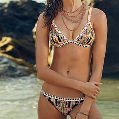 Victoria's Secret Mixed Ikat Tribal Print Bikini New without tags! Bought it online and threw away the plastic packaging. Still has hygienic lining. Absolutely gorgeous but sadly too small for my bust. Top is a large and bottom is a small. Swim Bikinis