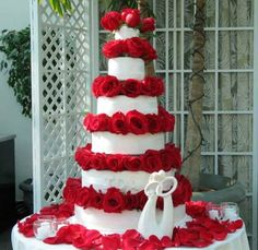 Cake Boss Wedding Cakes with red Flowers Look at that cool little ribbon on it.
