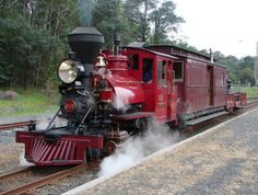 """A 2'6"""" gauge passenger train approaches a station on the Puffing Billy Railway in the mountainous region of the Australian state of Victoria. The train is exactly in my favourite colour - red."""