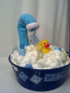 Mini Bath Tub Diaper Gift Basket....filled with sz2 pampers, Johnson & Johnson bathtime goodies, washclothes, blanket, teething ring, & rubber ducky.