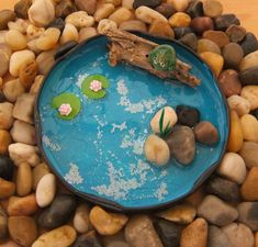 DIY fairy pond using recycled household items