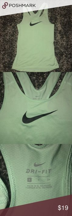 Nike dri fit tank pastel light green. Rarely worn! Nike racerback dri fit tank! Super silky material but fitted. Size small.  If you want to bundle anything else in my closet take a look! You'll get an additional discount on top of the 10% that's automatically taken off! I have tons of stuff!   🌸🌸🌸  Thanks for visiting! Nike Tops Tank Tops