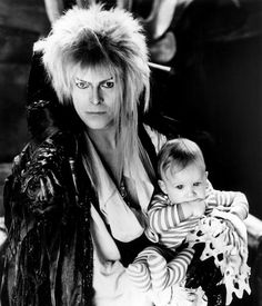 1986 - David Bowie as Jareth and Toby in Labyrinth. David Bowie Labyrinth, Labyrinth 1986, Labyrinth Movie, Labyrinth Tattoo, Goblin King, Jennifer Connelly, Labrynth, Last Unicorn, Fraggle Rock