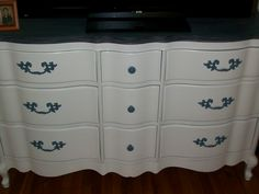 We stripped the top and stained it blue, painted the knobs to match.... Just love it