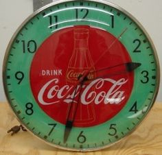 1950s Vintage Coca-Cola Clocks, Signs, Trays, Thermometers, Machines, Coolers, Glasses and other Coke memorabilia memorabilia available at the Brass Armadillo (816) 847-5260. they ship stuff!