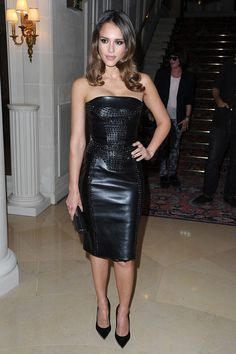Jessica Alba Leather Dress  Jessica Alba looked spicy in this leather strapless dress studded with Swarovski crystals.  Brand: Versace