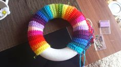 Crocheted wreath in rainbow colours Crochet Wreath, Crochet Crafts, Yarn Projects, Crochet Projects, Crochet For Kids, Free Crochet, Bruges Lace, Tunisian Crochet, Mobiles