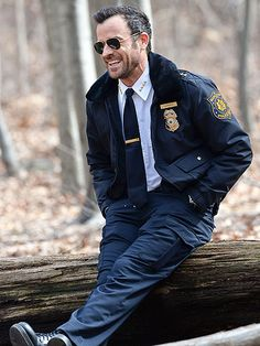 A LEG UP | Justin Theroux cracks a smile between takes while shooting HBO series The Leftovers Tuesday in Queens, N.Y.