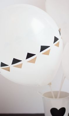 Cut vinyl into an endless variety of designs to decorate balloons!