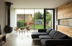 Monochrome living area with reclaimed timber interior wall and views to the garden. Modern extension to period home by McCann Moore Architects Belfast. Living Etc, Living Area, Living Room Decor, Garden Modern, Reclaimed Timber, Interior Walls, Belfast, Architects, Monochrome