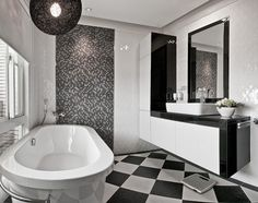 No wood here! The bathroom is purely monochromatic and offers a clean break from the rest of the home. There's nothing wrong with going for a completely different palette in a room as secluded as the bathroom, and in fact, such a bold change can help reset and reframe the mind – and that's what a nice long bath is all about, right?