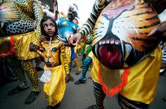 """Puli Kali in the Annual Festival Onam - A young boy participates in the """"tiger dance,"""" a 200-year-old colorful folk art performance. Painting tigers onto performers' bodies takes 6 to 7 hours.  Photographer Indranil Sengupta, taken in Thrissur, Kerala, India.  #world #culture #photography"""