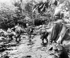 [Photo] Men of the US Marine Division fording a muddy jungle stream at Okinawa, Japan, circa Apr-Jun 1945 Homeless Veterans, Iwo Jima, Okinawa Japan, World War Ii, Marines, Ww2, Division, Vietnam, Explore