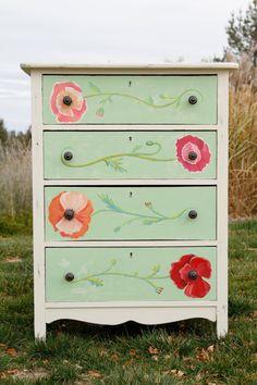 Green dresser with flower details.