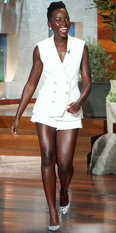 Love Her Outfit! | LUPITA NYONG'O | We're starting to sound like broken records with this phrase: Lupita wore an outfit we really like. Her style streak continues with a Veronica Beard tuxedo vest and shorts. We'd offer up tips on how to make the ensemble work, but it doesn't really require any. Just put on, glance in mirror, nod approvingly.