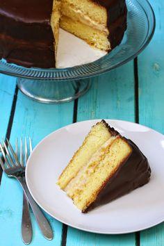 Boston Cream Pie (Cake) From Scratch with homemade Yellow Cake, pastry cream, and rich chocolate ganache.