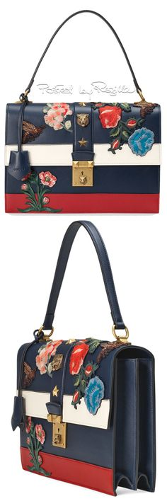 If it didn't have those flowers and a bigger star  It could be a TEXAS hand bag.