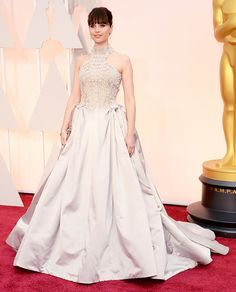 Felicity Jones in a beautiful lilac Alexander McQueen gown with a statement neckline at the 2015 Oscars