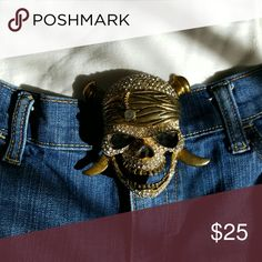Skull and Cross Bones belt buckle Die cast brass colored rhinestone belt buckle. Just in time for Halloween. Great addition to you pirate costume. This is only the buckle. Accessories Belts