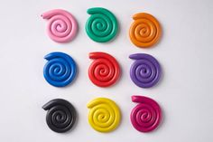 set of nine plasticine colorful spirals isolated on white background