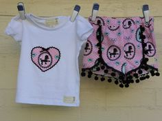 Size 3yrs Gidget shorts and t-shirt set in pink poodle print with black pompoms.    Items for sale on our Etsy store!  Custom orders also available  Find us on Facebook too: Http://www.facebook.com/pollymophandmade