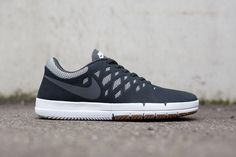 "Nike has dropped the ""Dark Grey"" iteration of its Nike Free SB silhouette. The low top sneaker features a dark grey suede upper, layered over white, patterned mesh detailing. A charcoal filled Nike Sw..."