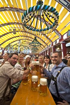 Prousit!   A bunch of tourist drunks at the head table at Oktoberfest, Munich, Germany...  They had to kill to get these seats....literally.