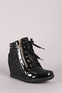 "This high top wedge sneaker features a shiny patent upper with sparkling glitter accents, rounded toe, decorative zipper trim, and covered wedge heel. Finished with a cushioned insole, padded collar/tongue, and lace up closure. Material: Vegan Patent Leather (man-made) Sole: Rubber Measurement Heel Height: 2.5"" (approx) Shaft Length: 6.25"" (including heel) Top Opening Circumference: 9"" (approx)"
