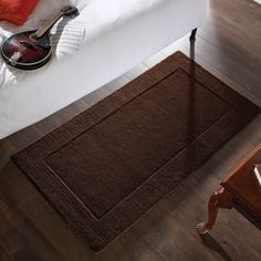 Tuscany Rugs are handmade in India with a luxurious, 100% wool pile. #Bedroom #BrownRugs