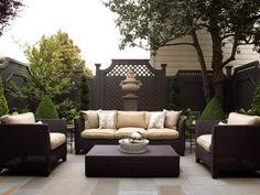 Stylish patio, charcoal lattice fence and furniture - Candace Cavanaugh Interiors