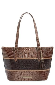 Free shipping and returns on Brahmin 'Medium Asher' Croc Embossed Leather Tote at Nordstrom.com. A chic, modern mix of textures and tones styles this high-gloss leather satchel done in a manageable size. Convenient adjustable straps and signature Brahmin touches, including a light-colored lining, pen loops and a key clip, add to the bag's versatility. Gleaming goldtone hardware and tassels add a final touch of polish.